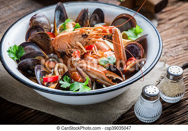 Tasty seafood soup with mussels and langoustines - csp39035047