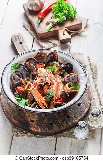 Tasty seafood soup with shrimps and mussels - csp39105754