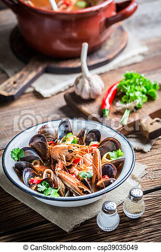Tasty seafood soup with shrimps and mussels - csp39035049