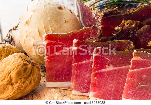 Tasty slices of Italian speck - csp13958038