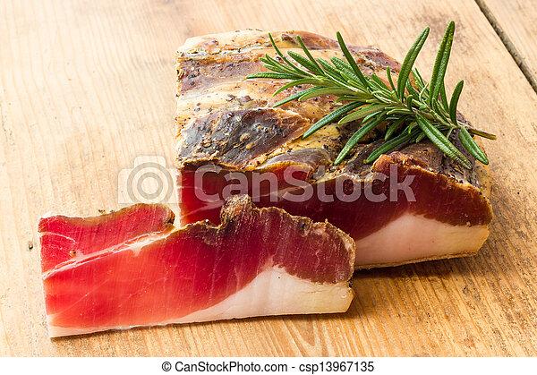 Tasty slices of Italian speck - csp13967135