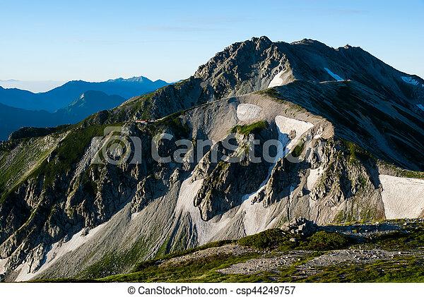 Tateyama mountain range lit by the morning sun - csp44249757