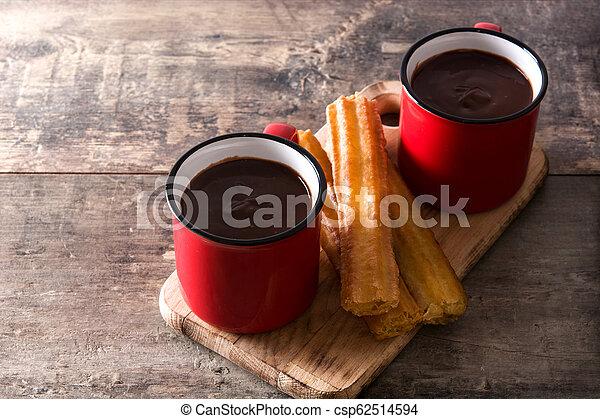 tavola legno, cioccolato caldo, churros - csp62514594