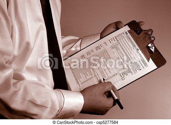 Tax Accountant Consultant paperwork - csp5277584