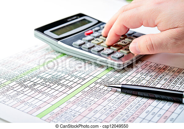 Tax forms, spread sheet with pen and calculator. - csp12049550