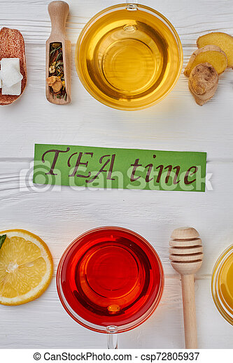 Tea composition on wooden background, flat lay. - csp72805937