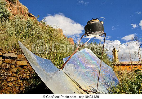 tea kettle boiling by solar parabolic reflector - csp18431439