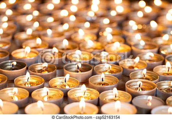 Tea light candles burning bright. Selective focus Christmas and remembrance image. - csp52163154