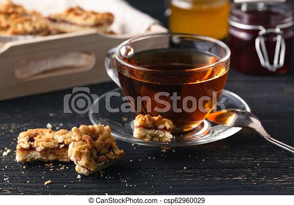 Tea with gingebread cookies in christmas evening - csp62960029
