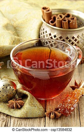 Tea with spices - cinnamon, - csp13584832