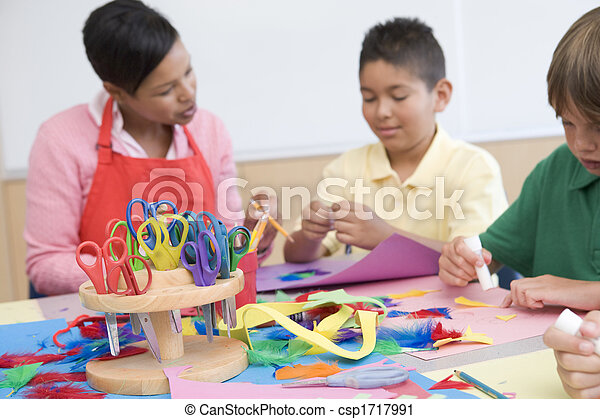 Teacher and students in art class (selective focus) - csp1717991