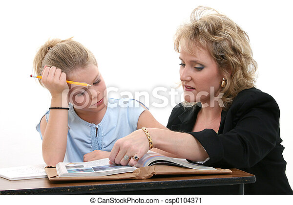 Teacher Helping Student at Desk - csp0104371