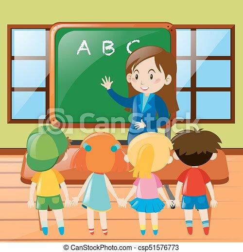 Teacher teaching in classroom - csp51576773