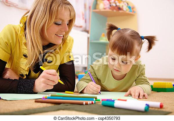 Teacher with child in preschool - csp4350793