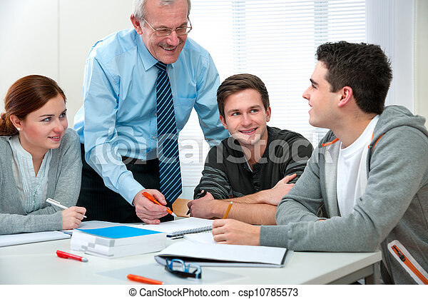 Teacher with students in classroom - csp10785573