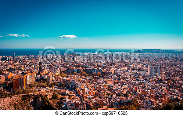 Teal and orange view of Barcelona from the Carmel bunkers viewpoint - csp59716525