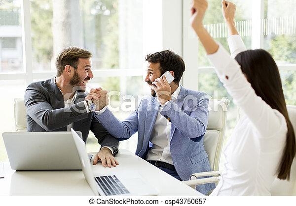 Team building in a modern office - csp43750657
