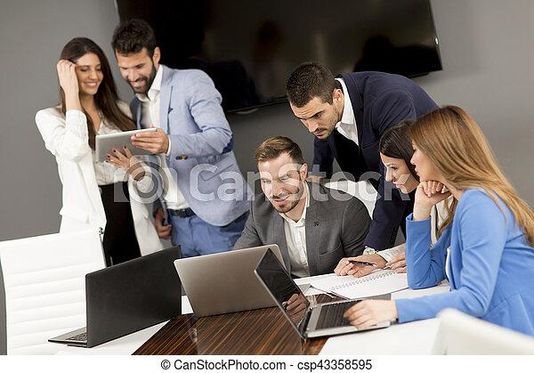 Team building in a modern office - csp43358595