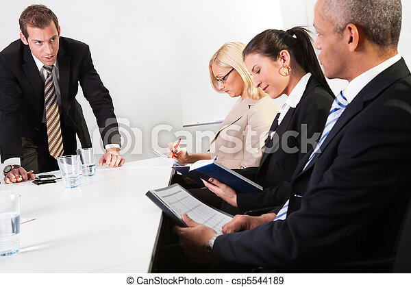 Team of business people taking notes - csp5544189