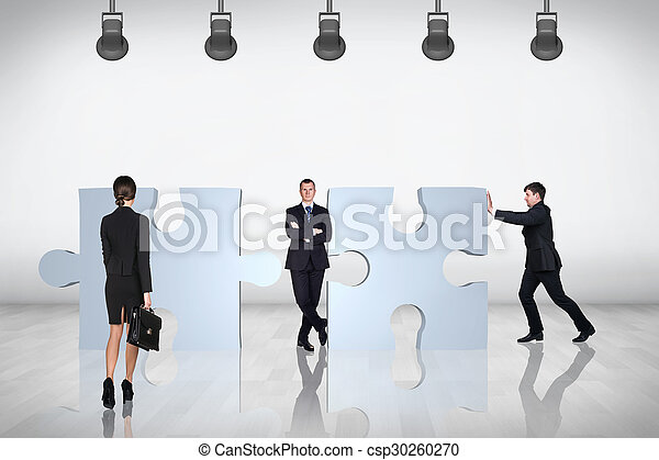 Team of business people try to join puzzle - csp30260270