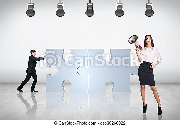 Team of business people try to join puzzle - csp30260322