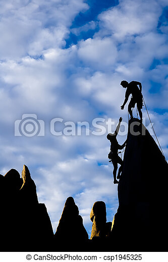 Team of climbers on the summit. - csp1945325