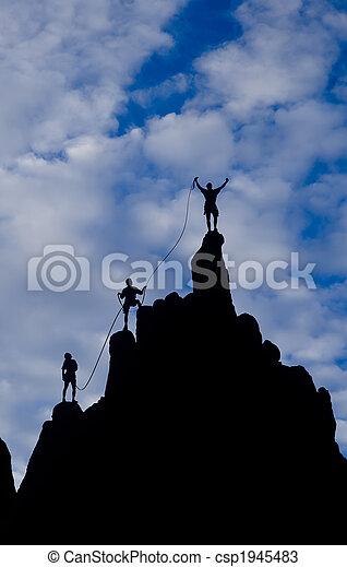 Team of climbers reaching the summit. - csp1945483