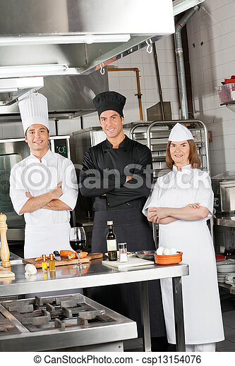 Team Of Confident Chefs In Industrial Kitchen - csp13154076