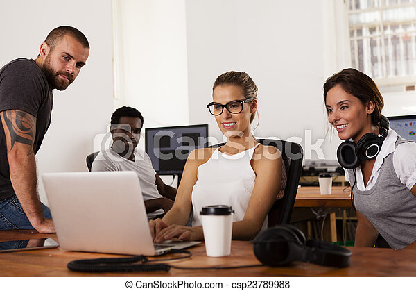 Team of entrepreneurs in a startup office - csp23789988