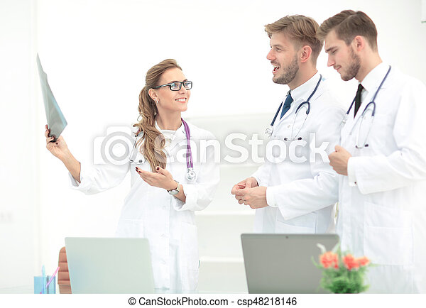 Team of medical professionals working at the medical office ...