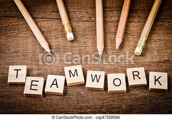 TEAMWORK word written on wood block with wood pencils. - csp47358566