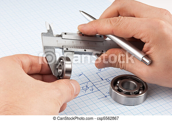 Technical drawing and callipers with bearing in hand - csp5562867