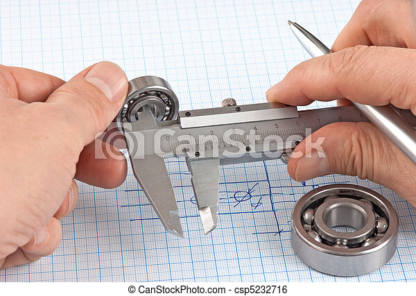 Technical drawing and callipers with bearing in hand - csp5232716