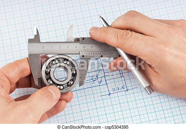 Technical drawing and callipers with bearing in hand - csp5304395