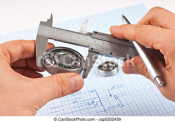 Technical drawing and callipers with bearing in hand - csp5202439