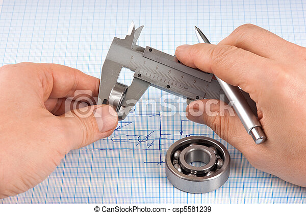 Technical drawing and callipers with bearing in hand - csp5581239