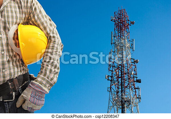 technician against telecommunication tower, painted white and red in a day of clear blue sky.  - csp12208347