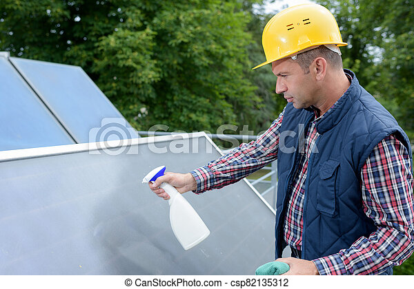technician checks the maintenance of the solar panels - csp82135312