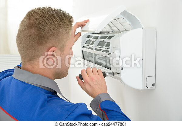 Technician Repairing Air Conditioner - csp24477861
