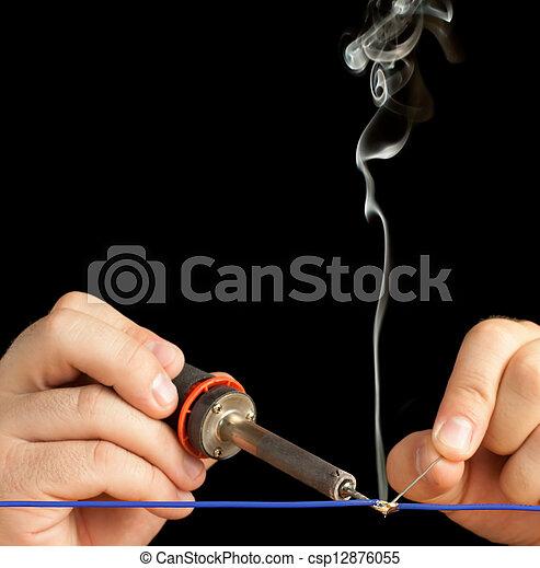 Technician soldering two wires - csp12876055