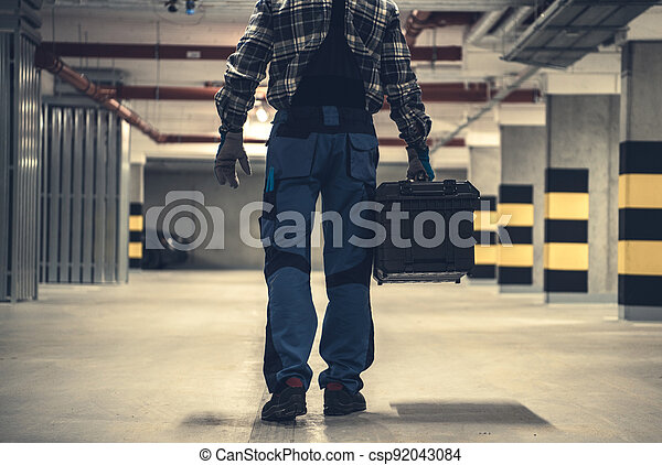 Technician Worker with Large Tools Box in Hands - csp92043084
