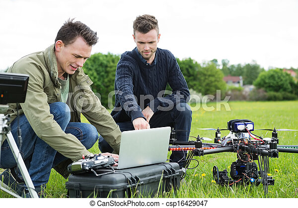 Technicians Using Laptop By UAV Drone - csp16429047