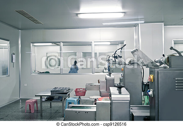 Technicians working in the pharmaceutical production line - csp9126516