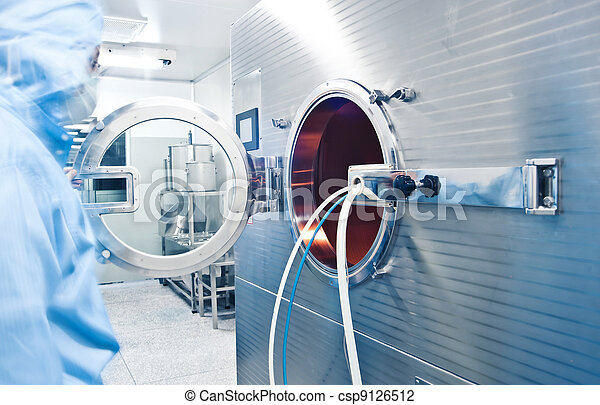 Technicians working in the pharmaceutical production line - csp9126512