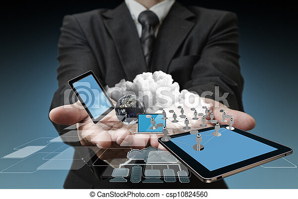 Technology in the hands of businessmen - csp10824560