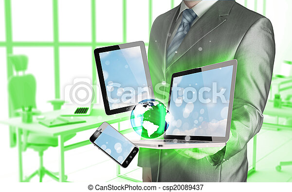 Technology in the hands of businessmen - csp20089437