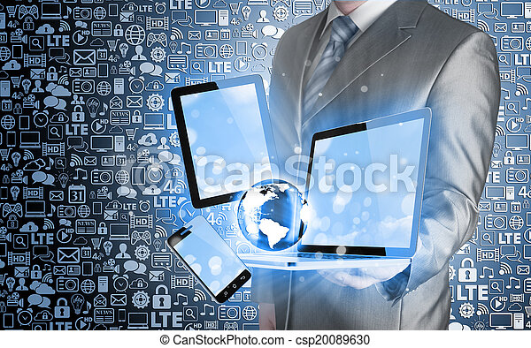 Technology in the hands of businessmen - csp20089630