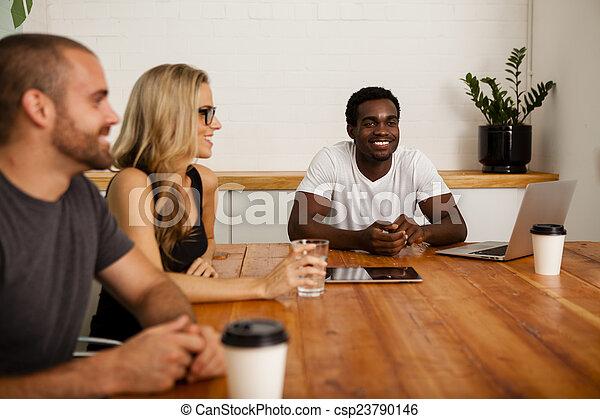 Technology startup team meeting - csp23790146