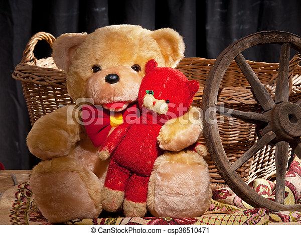 teddy bear is sitting in front of wicker basket - csp36510471