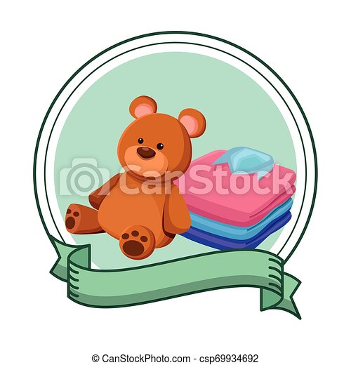 teddy bear toy and folded clothes - csp69934692